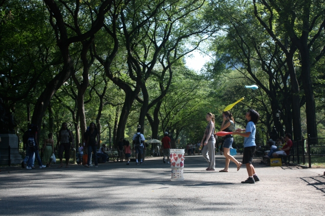 A child juggling in Central Park